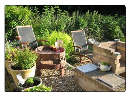 Relaxing on the patio with BBQ at Lothlorien Self Catering Holiday Cotage in Wales